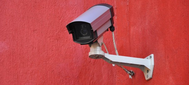 security camera against a red background