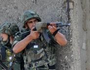 Bulgarian soldiers holding Kalashnikov semi automatic rifles