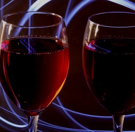 wine glasses containing red wine amid moody wisps of smoke