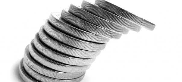 a pile of silver coins tilting to the left
