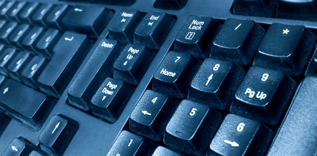 dark blue computer keyboard with black keys
