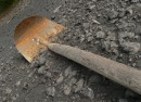photo of shovel or spade on gravel. Photo: Sascha Hoffman/sxc.hu