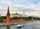 river boat near Kremlin buildings in Russia's capital city Moscow