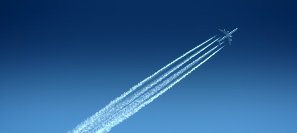 Aircraft in the sky with vapour trails
