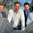 David Cameron, middle, and Vladimir Putin, right, look at a model of the Fisht Olympic Stadium in Sochi. Photo: kremlin.ru
