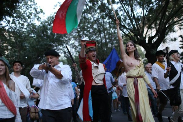 Anti-government protests frequently came up with creative imagery and events, such as the nod to the Delacroix painting and Bastille Day, a gesture of tribute after the French and German ambassadors issued a public statement urging the government to heed the voice of civil society. Photo: Vassil Garnizov