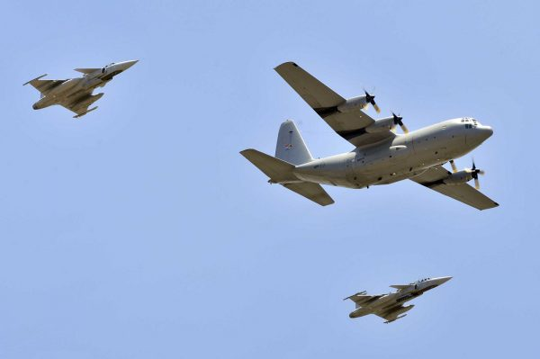 A South African Air Force transport aircraft, escorted by fighter jets, bearing Mandela's remains from Tshwane to Mthatha. Photo: flickr.com/photos/governmentza