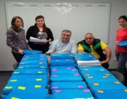 Georgi Bliznashki, middle, and Boiko Borissov, second right, posing with the folders containing the signatures in support of the petition to hold the referendum, collected by GERB, on March 9. Photo: gerb.bg