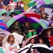 Wimbledon spectators wait under the rain. Photo: SNappa2006/flickr.com