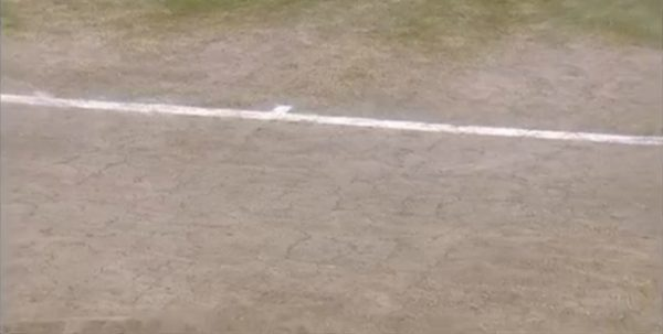 Screenshot of caked dirt alongside the baselines of the Centre Court via BBC.