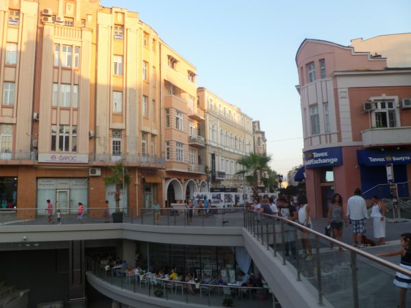 Part of the main shopping street, with the Roman Stadium and its newly-opened coffee shop.