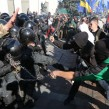 Far-right parties and movements activists clash with riot police in front of the Ukrainian Parliament in Kyiv on Oct. 14.