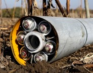 Remnants of a misfired Uragan cluster munition rocket lying in a field in territory controlled by the Ukrainian government near Novomykhailivka, Ukraine on Oct. 14.