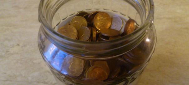 Glass jar of Bulgarian stotinki coins Photo copyright Clive Leviev-Sawyer