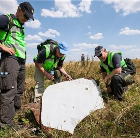 Dutch and Australian investigators at the MH17 crash site. The investigation was an extremely difficult task given obstacles to proper access. The MH17 tragedy spurred sanctions against Russia by the EU and US. Photo: Netherlands defence ministry.