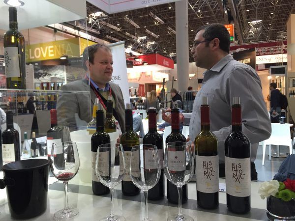 Lovico Suhindol winemaker Stanimir Stoyanov, right, talks with a client