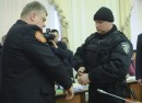 Serhiy Bochkovsky, head of the State Service for Emergency Situations, being arrested by a police officer at a Cabinet meeting on March 25.