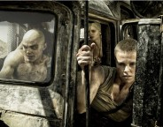 Still of Charlize Theron and Nicholas Hoult in Mad Max: Fury Road. © 2014 - Warner Bros.