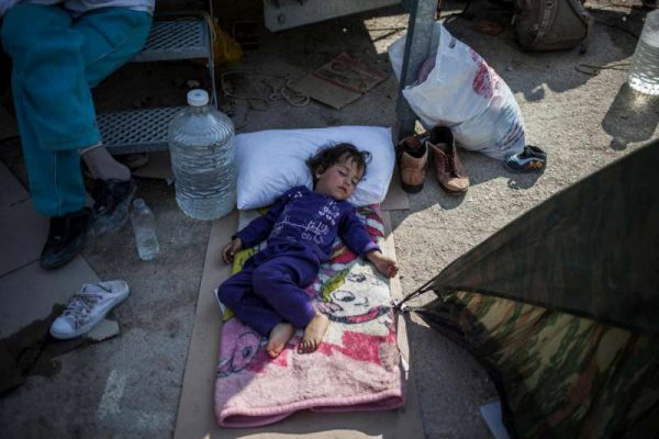 A child sleeps outside the screening centre at Moria on Lesvos. Refugees and migrants live in tents outside the screening centre here until there is a space available to accommodate them inside. Photo: UNHCR/S. Baltagiannis