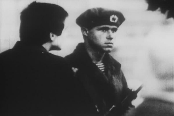 A Prague resident tries to talk to a Soviet soldier. Photo: National Archives
