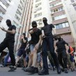 Masked members of the Right Sector try to violently break up a gay march in Kyiv on June 6. More than two dozen members were arrested. Five police officers were injured. © Pavlo Podufalov