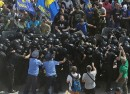 Activists of radical Ukrainian parties, including the Ukrainian nationalist party Svoboda Freedom, clash with police officers in front of the parliament in Kiev on August 31 2015.