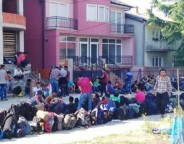Photo: IOCC.org – Syrian refugees gather outside of the police station in Presevo, Serbia, where they are waiting to be registered for assistance.