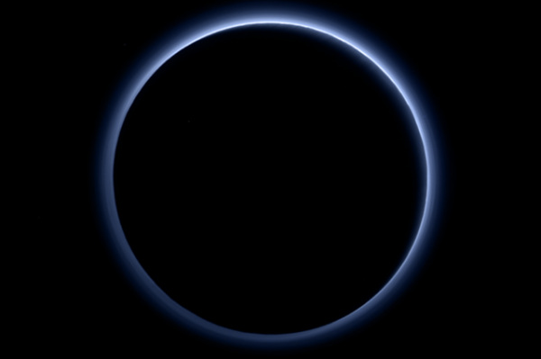 Pluto's Blue Sky: Pluto's haze layer shows its blue color in this picture taken by the New Horizons Ralph/Multispectral Visible Imaging Camera (MVIC). The high-altitude haze is thought to be similar in nature to that seen at Saturn's moon Titan. The source of both hazes likely involves sunlight-initiated chemical reactions of nitrogen and methane, leading to relatively small, soot-like particles (called tholins) that grow as they settle toward the surface. This image was generated by software that combines information from blue, red and near-infrared images to replicate the color a human eye would perceive as closely as possible. Photo: NASA/JHUAPL/SwRI