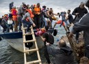 Asylum seekers and migrants descend from a large fishing vessel used to transport them from Turkey to the Greek island of Lesbos October 11 2015 2015 Zalmaï for Human Rights Watch