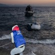 IOM staff rescue migrants from an overturned boat on the island of Kos