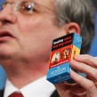 Former EU health commissioner Tonio Borg shows a sample of a combined text and graphic warning on a cigarette package in December 2012. Photo: Roge Thierry/EC Audiovisual Service
