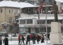 A statue of former US President Bill Clinton looking towards Bill Clinton Boulevard on a snowy January afternoon in Pristina Kosovo  Jan  18 2016 P.W. Wellman VOA