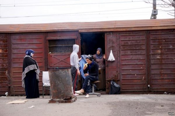 In addition to living in tents, Syrian families have also been camping out in unused freight cars photo Jamie Dettmer VOA