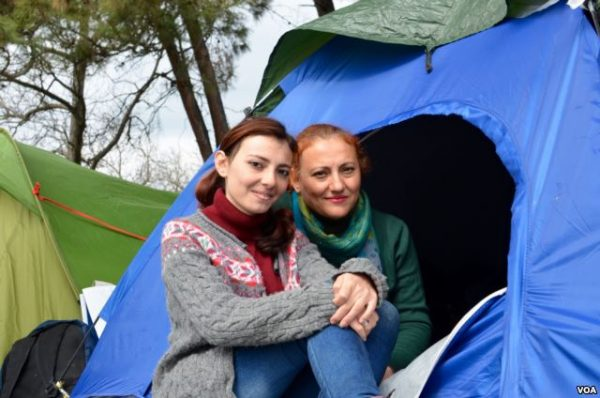 Ramia Sabbagh and her mother in front of their tent at the Idomeni camp Jamie Dettmer VOA