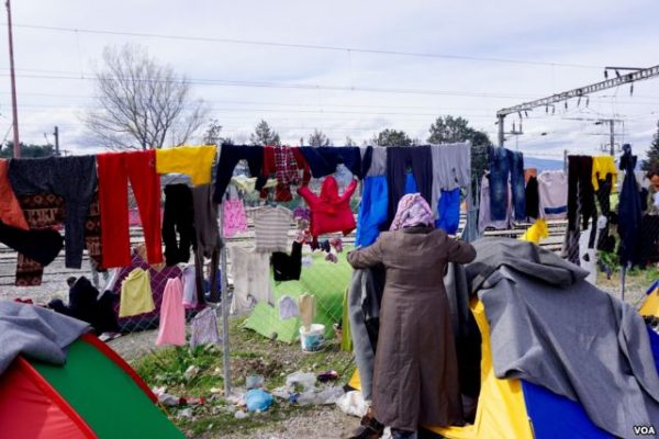 Refugees at the Idomeni encampment try to dry out clothing and bedding between rainstorms.