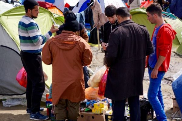Some enterprising refugees have been buying basic foodstuffs to resell to others living in the makeshift camp at Idomeni.