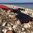 A life jacket discarded on the beach as refugees and other migrants are still arriving by the hundreds daily, according to people inside the refugee camp in Lesbos, Greece, April 1 2016. (H. Murdock/VOA)